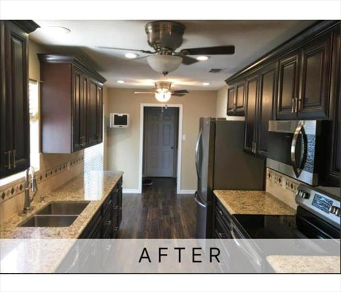 The same kitchen looks brand new after a full restoration following the fire.