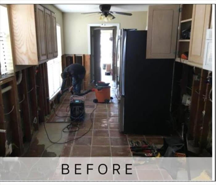 This kitchen has been damaged by fire resulting in removal of cabinets and drywall.