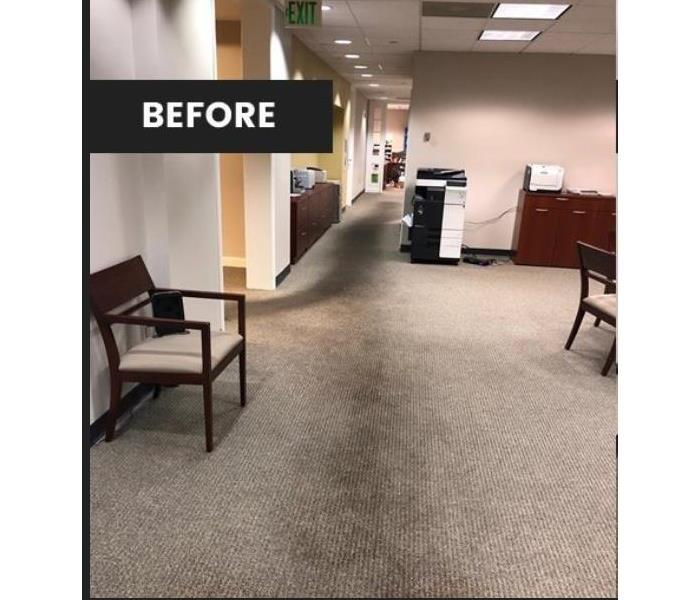 dirty carpet in office with chair, copier and desk